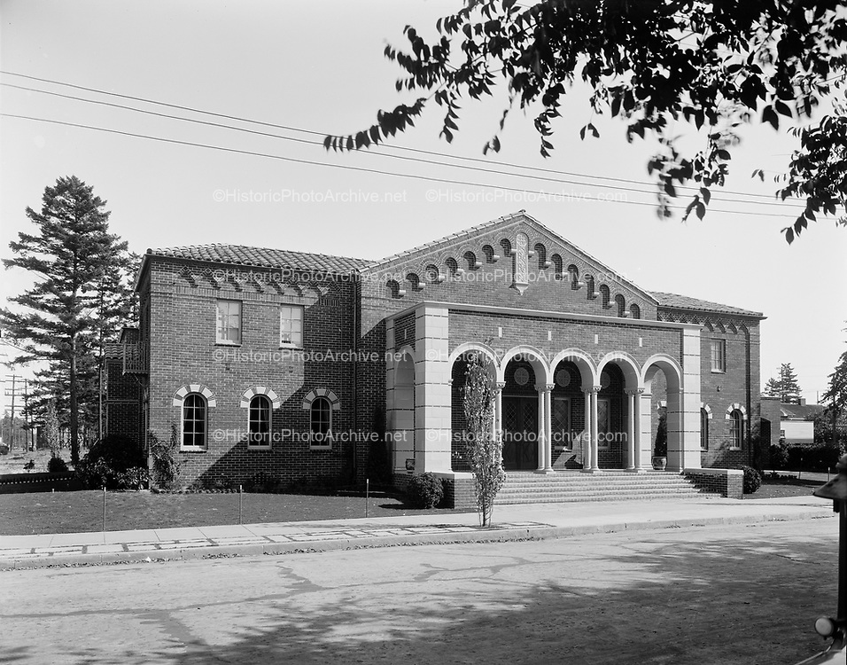 0503-01.  Wilson Chambers funeral home,  shortly after construction in 1933, later known as the Little Chapel of the Chimes, and now McMenamins Chappel Pub. 430 N Killingsworth, on the SE corner of Killingsworth & Commercial. This photo shows the side of the building facing N. Commercial street.