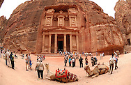 The Treasury (El-Khazneh) in Petra, Jordan on Friday, April 28, 2006. Petra is considered the most famous and gorgeous site in Jordan located about 262 km south of Amman and 133 km north of Aqaba. It is the legacy of the Nabataeans, an industrious Arab people who settled in southern Jordan more than 2000 years ago. Admired then for its refined culture, massive architecture and ingenious complex of dams and water channels, Petra is now a UNESCO world heritage site that enchants visitors from all corners of the globe.