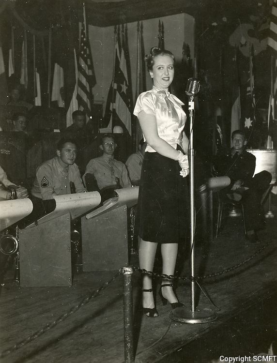 11/22/45 Celeste Holm on stage during the Hollywood Canteen's last night of operation.