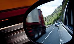 04.05.2011, Schwarzarch, AUT, FEATURE VERKEHR, im Bild Gegenverkehr, LKW im Rückspiegel eines Autos das im Stau steht, THEMENBILD STAU, VERKEHR // Oncoming traffic in the rearview mirror of a car in the traffic jam, THEME IMAGE / Feature TRAFFIC JAM, TRANSPORT,EXPA Pictures © 2011, PhotoCredit: EXPA/ J. Feichter