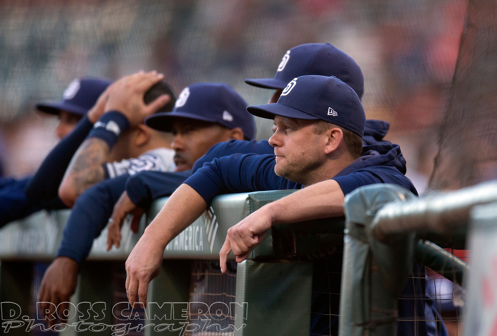 San Diego Padres manager Andy Green, right, watches his team take on the San Francisco Giants during a baseball game, Thursday, Aug. 29, 2019, in San Francisco. (AP Photo/D. Ross Cameron)