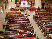 """15 MARCH 2020 - DES MOINES, IOWA: Pastor RACHEL THORSON MITHELMAN leads Sunday services at St. John's Lutheran Church in Des Moines. Attendance at St. John's was about ⅔ below normal for a Lenten Sunday this week. Most churches in the Des Moines area canceled their Sunday services or switched to an online service this week. The churches that conducted Sunday services imposed """"social distancing"""" guidelines, including no physical contact, and had significantly lower attendance. The Governor of Iowa announced Saturday night that the Coronavirus in Iowa had entered the """"community spread"""" phase when a person in Dallas County, in the Des Moines metropolitan area, tested positive for Coronavirus. This is the first reported case in the Des Moines area. As of Sunday morning, Iowa was reporting 18 people tested positive for Coronavirus.           PHOTO BY JACK KURTZ"""