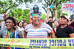 JOHANNESBURG, SOUTH AFRICA – APRIL 07: Protestors gather outside the Gupta's Saxonwold residence call for President Zuma to step down, the Guptas through their businesses are accused of links to goverment officials and the president, in Johannesburg, South Africa, 07 April 2017. Businesses closed and South Africans from numerous political, religious, labour and civic groups gathered at central points across the entire country protesting against President Zuma's recent government reshuffle appointing 10 new ministers and 10 new deputy ministers including the axing of the finance minister. Photo: Dino Lloyd