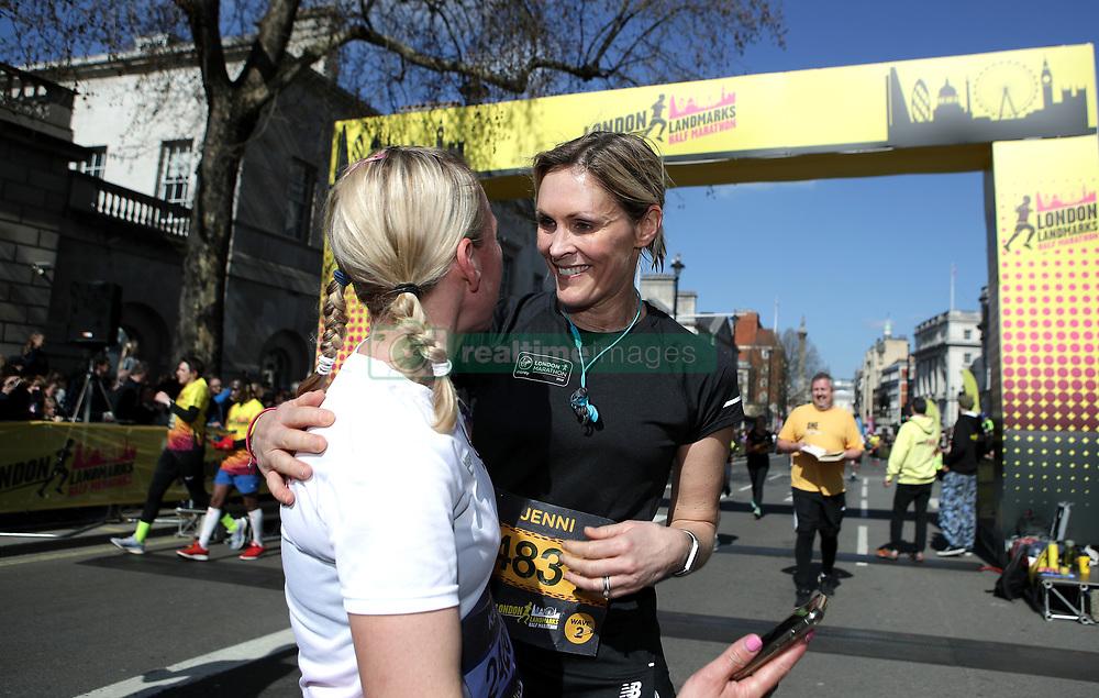 Competitor Jenni Falconer crosses the finish line during the 2019 London Landmarks Half Marathon.