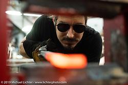 Custom bike builder / Knife maker Lock Baker forging his own Damascus steel blades in his Los Angeles shop. CA, USA. Thursday, June 21, 2018. Photography ©2018 Michael Lichter.