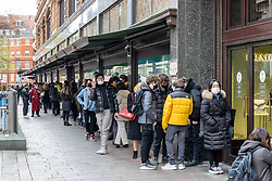 Licensed to London News Pictures. 12/04/2021. London, UK. Members of the public queue outside Harrods in London before doors open at the World famous Knightsbridge department store as pubs and shops across England welcome back customers as Covid-19 restrictions are lifted today. Prime Minister Boris Johnson announced last week that non-essential shop, restaurants with outside seating , hairdressers and gyms can reopen today after 4 months of Covid-19 lockdowns. Photo credit: Alex Lentati/LNP
