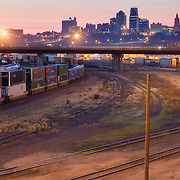 Kansas City Missouri skyline at dawn, view from Mill Street bridge above rail yards in Kansas City, Kansas.