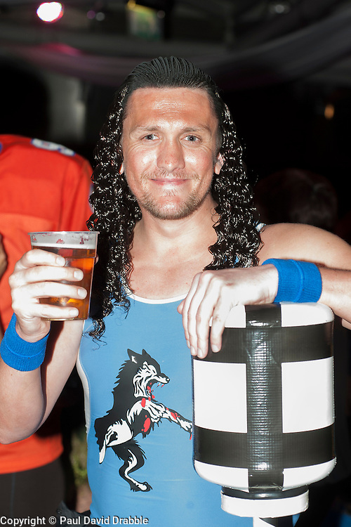"""The Hubs, Hallam Union, Paternoster Row plays host to Sheffield's biggest Fancy Dress Ball. More than 900 people in fancy dress to raise money for Cancer Research on Saturday night The Gladiators """"Wolf"""" enjoys a pint..6 April  2013.Image © Paul David Drabble"""