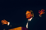 Cahrismatic American evangelist, Billy Graham preaches with open hands to British Christians during Mission 89, a series of evangelical revival rallies, on 14th June 1989 in London, England. Graham b1918 is an Evangelical Christian who has been a spiritual adviser to several U.S. presidents including George W Bush with Time Magazine calling him .. the nations spiritual counselor. He is number seven on Gallups list of admired people for the 20th century and member of the Southern Baptist Convention.