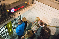 Commuters wait at the gates of Oxford Circus tube station because of an incident. London