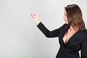 Woman in black business suit holds out an empty hand Model released