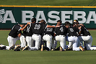 28 May 2016: Nova Southeastern's players huddle before the game. The Nova Southeastern University Sharks played the Franklin Pierce University Ravens in Game 3 of the 2016 NCAA Division II College World Series  at Coleman Field at the USA Baseball National Training Complex in Cary, North Carolina. Nova Southeastern won the game 4-3 in twelve innings.