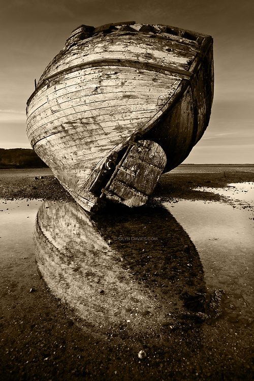 Nominated for 11th International B&W Spider Awards<br /> <br /> One of two fishing boats which have been left to deteriorate in the Dulas Estuary in East Anglesey. As the estuary is relatively well protected from the open sea, the wrecks have hardly moved in many years, but are very gradually looking more broken