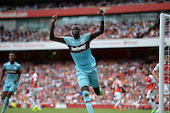 Cheikhou Kouyate of West Ham United celebrates scoring his sides first goal of the game the make it 0-1. Barclays Premier League, Arsenal v West Ham Utd at the Emirates Stadium in London on Sunday 9th August 2015.<br /> pic by John Patrick Fletcher, Andrew Orchard sports photography.