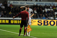 Swansea city's Michu shows the assistant ref his injured head.  Europa league group A match, Swansea city v FC St. Gallen at the Liberty Stadium in Swansea, South Wales on Thursday 3rd October 2013. pic by Andrew Orchard , Andrew Orchard sports photography,