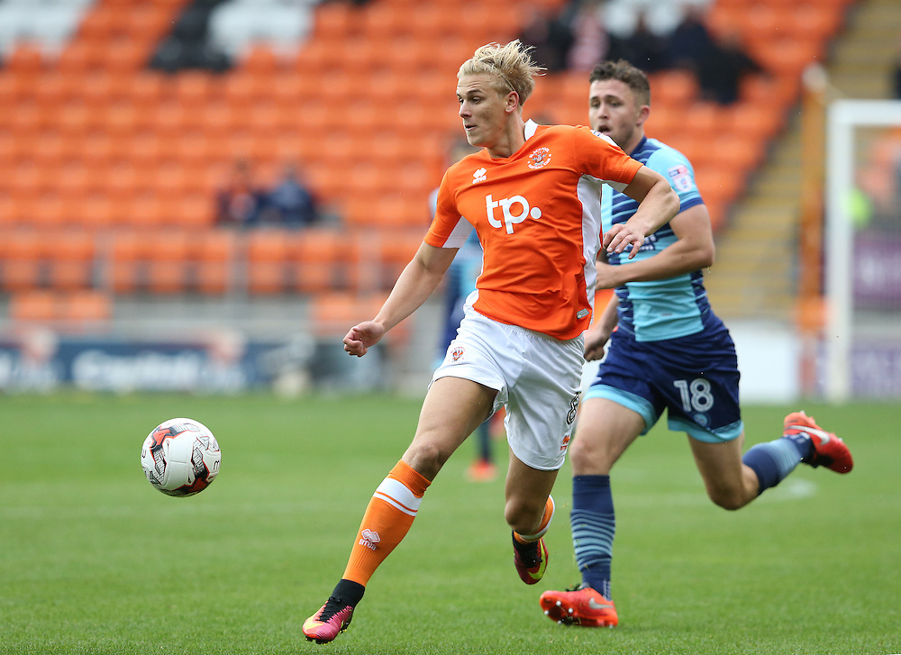 Blackpool's Brad Potts and Wycombe Wanderers' Dan Rowe<br /> <br /> Photographer Stephen White/CameraSport<br /> <br /> Football - The EFL Sky Bet League Two - Blackpool v Wycombe Wanderers - Saturday 20 August 2016 - Bloomfield Road - Blackpool<br /> <br /> World Copyright © 2016 CameraSport. All rights reserved. 43 Linden Ave. Countesthorpe. Leicester. England. LE8 5PG - Tel: +44 (0) 116 277 4147 - admin@camerasport.com - www.camerasport.com
