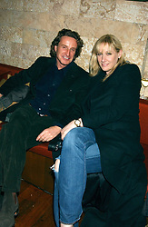 TIM ATTIAS and AMY SACCO owner of the famous Bungalow 8 club in New York at a party hosted by Daniella Helayel of fashion label ISSA held at Taman Gang, 141 Park Lane, London on 15th February 2006.<br />