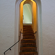 Steps and doorway lead to a viewing area above a Viking ship relic at the Viking Ship Museum in Oslo, Norway