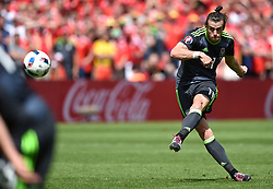 File photo dated 16-06-2016 of Wales' Gareth Bale scoring his sides first goal against England during the UEFA Euro 2016, Group B match at the Stade Felix Bollaert-Delelis, Lens. Issue date: Tuesday June 1, 2021.