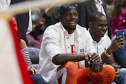 January 14, 2018 - Miami, FL, USA - Olympic sprinter Usain Bolt sits at the sidelines after the Miami Heat defeated the Milwaukee Bucks 97-79 on Sunday, Jan. 14, 2018 at the AmericanAirlines Arena in Miami, Fla. (Credit Image: © Matias J. Ocner/TNS via ZUMA Wire)