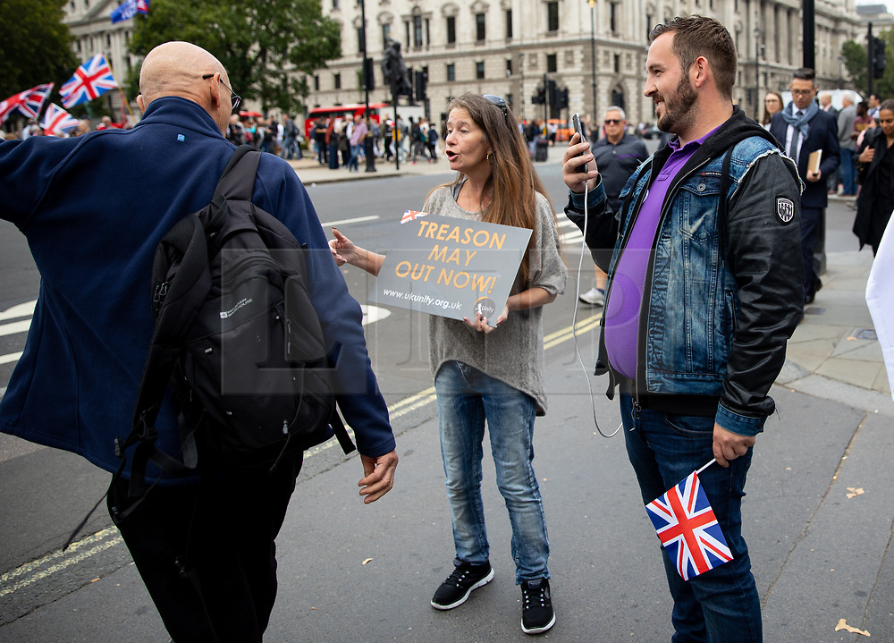 © Licensed to London News Pictures. 05/09/2018. London, UK. NOTE: FILE PHOTO. James Goddard (right) videos a passerby during a Brexit demonstration in September. Goddard has been accused of being part of the group calling Conservative MP Anna Soubry a 'Nazi' on Monday this week. [ORIGINAL CAPTION: Anti-Brexit demonstrators and some far-right sympathisers campaign outside the Houses of Parliament, calling for Britain's immediate exit from the EU, and the re-instating of former Foreign Secretary Boris Johnson.] Photo credit : Tom Nicholson/LNP