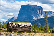 Derelict log cabin below Square Top Peak in the Wind River Mountains of Wyoming.