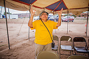 "14 JULY 2012 - FT DEFIANCE, AZ:   A woman raises her hand in praise during the ""Singspiration"" gospel jam at the 23rd annual Navajo Nation Camp Meeting in Ft. Defiance, north of Window Rock, AZ, on the Navajo reservation. Preachers from across the Navajo Nation, and the western US, come to Navajo Nation Camp Meeting to preach an evangelical form of Christianity. Evangelical Christians make up a growing part of the reservation - there are now more than a hundred camp meetings and tent revivals on the reservation every year. The camp meeting in Ft. Defiance draws nearly 200 people each night of its six day run. Many of the attendees convert to evangelical Christianity from traditional Navajo beliefs, Catholicism or Mormonism. ""Camp meetings"" are a form of Protestant Christian religious services originating in Britain and once common in rural parts of the United States. People would travel a great distance to a particular site to camp out, listen to itinerant preachers, and pray. This suited the rural life, before cars and highways were common, because rural areas often lacked traditional churches.  PHOTO BY JACK KURTZ"