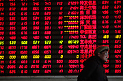 Investors monitor prices and make trades at a securities exchange house in Shanghai, China on 30 December 2011.  China's A shares had the biggest drop in a year following the global down turn as well as monetary tightening concerns in China.