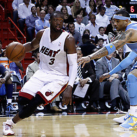 19 March 2011: Miami Heat shooting guard Dwyane Wade (3) drives past Denver Nuggets power forward Kenyon Martin (4) during the Miami Heat 103-98 victory over the Denver Nuggets at the AmericanAirlines Arena, Miami, Florida, USA.