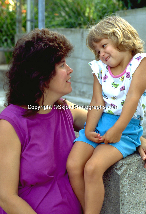 Mom age 29 with daughter age 3 shrugging her shoulders.  St Paul Minnesota USA