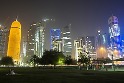 Night view of modern skyline with skyscrapers in business district of Doha Qatar