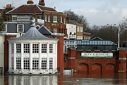 © Licensed to London News Pictures. 01/08/2014. The swollen river rises up against the Riverside restaurant and pub at Hampton court. Recent bad weather has caused the river Thames in south west London and Surrey to reach very high levels. Credit : Rob Powell/LNP
