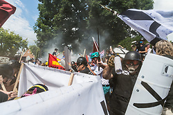 August 12, 2017 - Charlottesville, Virginia, U.S. - Neo-Nazis, white supremacists and other alt-right factions scuffled with counter-demonstrators near Emancipation Park (Formerly ''Lee Park'') in downtown Charlottesville, Virginia. After fighting between factions escalated, Virginia State Police ordered the evacuation by all parties and cancellation of the ''Unite The Right'' rally scheduled to take place in the park. (Credit Image: © Albin Lohr-Jones/Pacific Press via ZUMA Wire)