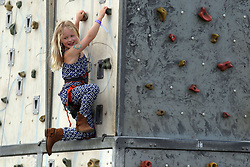 Peter and Autumn Phillips daughter Savannah, on a climbing wall during the Royal Windsor Horse Show, which is held in the grounds of Windsor Castle in Berkshire.
