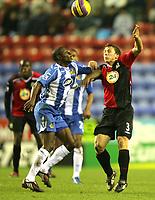 Photo: Paul Greenwood/Sportsbeat Images.<br />Wigan Athletic v Blackburn Rovers. The FA Barclays Premiership. 15/12/2007<br />Wigan's Julius Agahowa, (L) battles with Blackburns Stephen Warnock