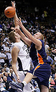 Fresno Pacific center Tyler Goslinga, right, is fouled by BYU center James Anderson (15) during the second half of an NCAA college basketball game, Saturday, Jan. 1, 2011, in Provo, Utah. BYU defeated Fresno Pacific 93-57.(AP Photo/Colin E Braley)