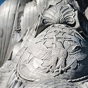 Detail of a shield etched into the base of the Navy-Merchant Marine Memorial in Arlington, Virginia, on Columbia Island on the banks of the Potomac across from Washington DC. The memorial honors those who lost their life at sea in World War I and was dedicated in 1934. The main sculpture is cast from aluminum.