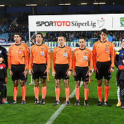 Referee's Cuneyt Cakir (C) during their Turkish Super League soccer match Caykur Rizespor between Fenerbahce at the Yeni Rize Sehir stadium in Rize Turkey on Saturday, 04 April 2015. Photo by TVPN/TURKPIX