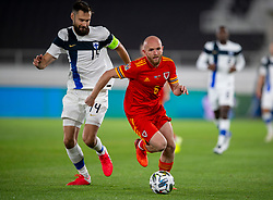 HELSINKI, FINLAND - Thursday, September 3, 2020: Wales' Jonathan Williams (R) gets away from Finland's captain Tim Sparv during the UEFA Nations League Group Stage League B Group 4 match between Finland and Wales at the Helsingin Olympiastadion. (Pic by Jussi Eskola/Propaganda)