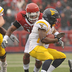Dec 5, 2009; Piscataway, NJ, USA; West Virginia running back Noel Devine (7) is tracked down by Rutgers linebacker Damaso Munoz (17) during first half NCAA Big East college football action between Rutgers and West Virginia at Rutgers Stadium.