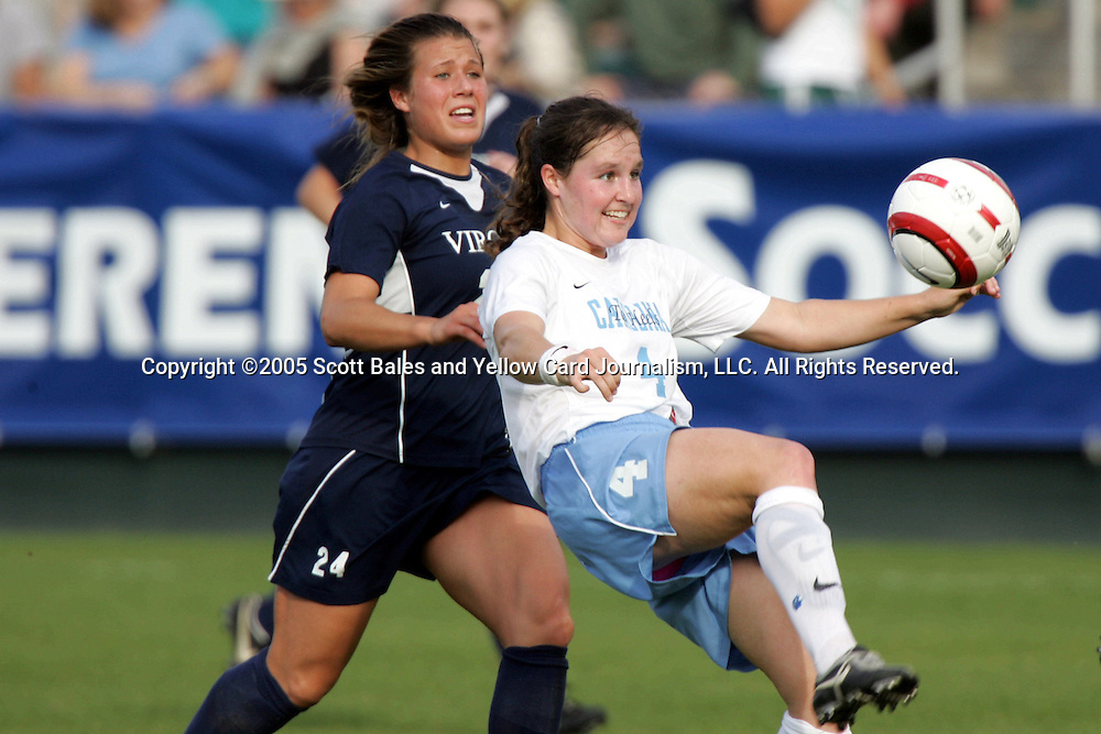 6 November 2005: North Carolina's Kendall Fletcher (right) prepares to clear the ball over her head as Virginia's Kelly Quinn (left) applies pressure. The University of North Carolina defeated the University of Virginia 4-1 at SAS Stadium in Cary, North Carolina in theifinals of the 2005 ACC Women's Soccer Championship.