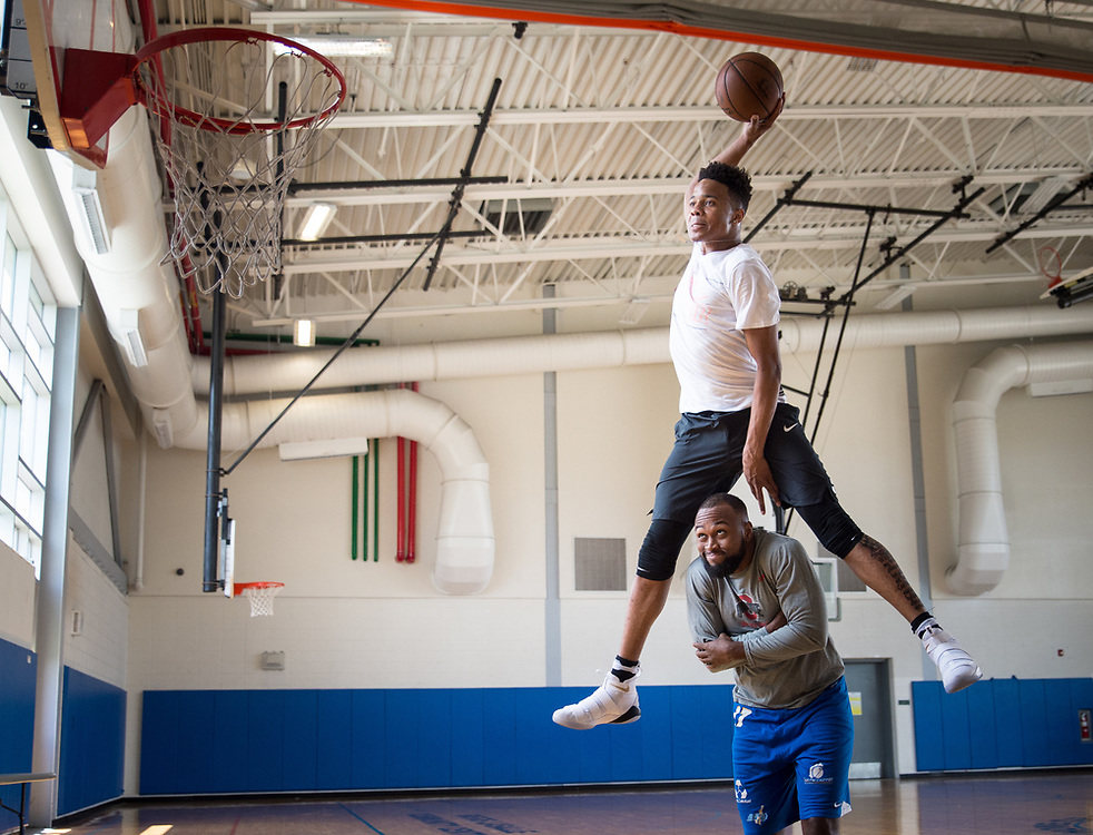 Markelle Fultz, the number one pick in the 2017 NBA Draft, selected by the Philadelphia 76ers, dunks over his friend Kenneth Tappin after working out together at the Riggs LaSalle recreation center in Northeast Washington, DC on June 27 2017.