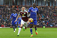 Robbie Brady of Burnley (l) and Victor Moses of Chelsea challenge for the ball. Premier league match, Burnley v Chelsea at Turf Moor in Burnley, Lancs on Sunday 12th February 2017.<br /> pic by Chris Stading, Andrew Orchard Sports Photography.