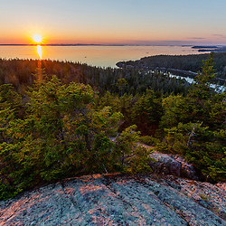 Sunset as seen from Duck Harbor Mountain on Isle au Haut in Maine's Acadia National Park.
