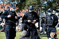 SYDNEY, NSW - SEPTEMBER 05: Police ask people to move out of the area during the Freedom Day Rally on September 05, 2020 in Sydney, Australia. Protesters argue COVID-19 is a hoax and say their freedoms are being unfairly impinged. Demonstrations are also taking place in every Australian capital city and several regional areas, including Byron Bay. (Photo by Steven Markham/Speed Media)