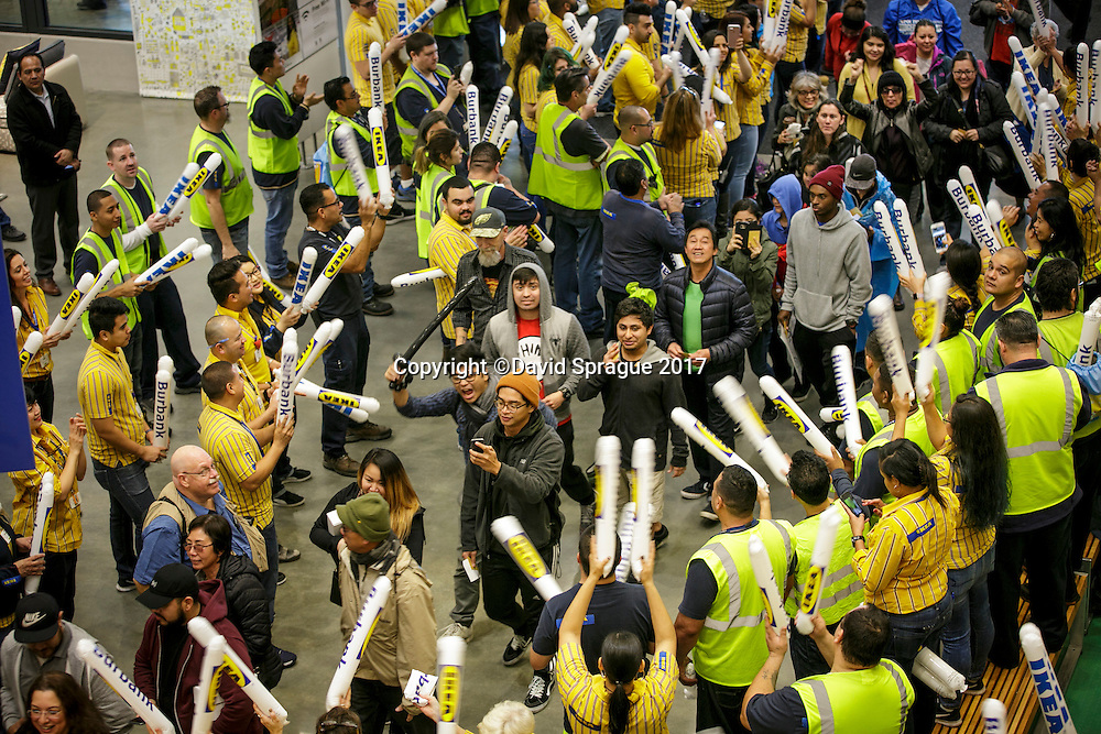 Workers line up to welcome the first shoppers at the grand opening of the new Ikea in Burbank. The new Ikea store comes in at 456,000 sf, compared to the old one at 242,000 sf. And 1,700 parking places.  Feb. 8, 2017  Photo by David Sprague