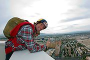 Travis Pastrana overlooks Las Vegas as he prepares for his base jump off The Signature at the MGM Grand Hotel & Casino on Wednesday June 1, 2011 in Las Vegas to promote the North American debut of Nitro Circus Live at the MGM Grand Garden Arena on Saturday June 4, 2011. (Jeff Bottari/AP Images for Nitro Circus Live)