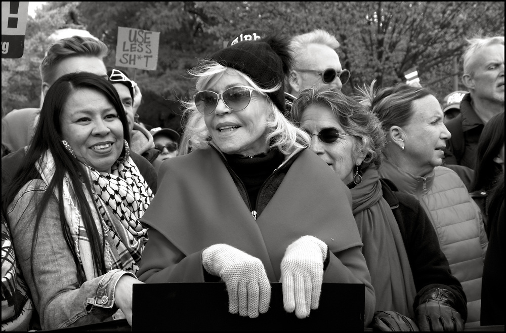 """On November 8, 2019 Remove Trump joined forces with Fire Drill Fridays and Jane Fonda for a March To Remove Trump from the Capital to The White House. Women's March, Rise and Resist, Veterans for Peace, and many other groups came together to participate. <br /> <br /> Along the march,  Rise and Resist members carried  a 600-square-foot impeachment clause banner.  After arriving at the White House the banner was unfurled while a group from Fire Drill Fridays blocked one of the entrances in a civil disobedience action. There were no arrests.<br /> <br /> In October of 2019, inspired by Greta Thunberg's call to act like """"our house is on fire"""" and guided by Naomi Klein's Green New Deal advocacy, Jane Fonda dropped all of her commitments and moved to DC so that — together with Greenpeace and other movement allies — she could launch """"Fire Drill Fridays,"""" which would be weekly protests centered around civil disobedience and a demand Congress pass the Green New Deal."""