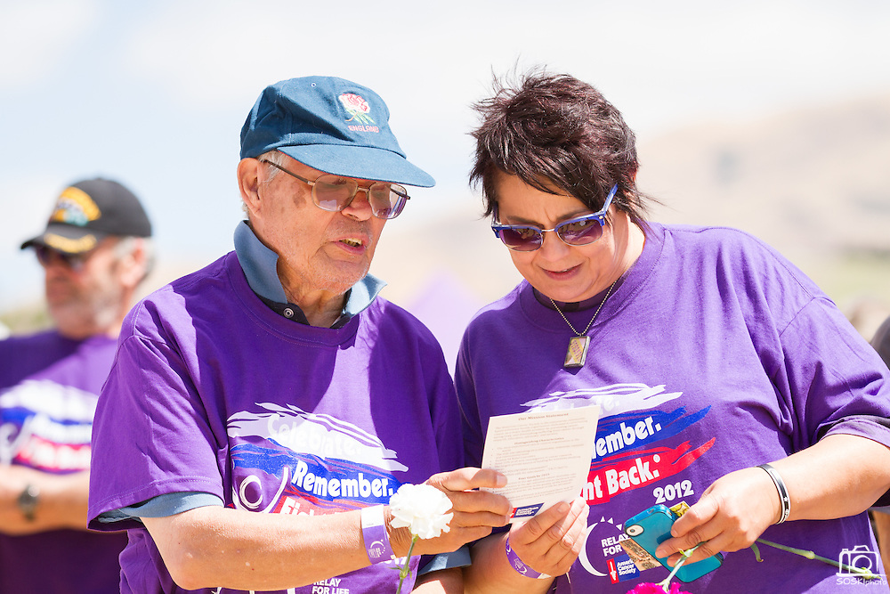 Charrisse Pommier and Al Pascual commit to fighting cancer during the opening ceremony of Relay For Life at the Milpitas Sports Center on June 23, 2012.  Pommier survived thyroid cancer and Pascual survived abdominal and rectal cancer.  Photo by Stan Olszewski/SOSKIphoto.