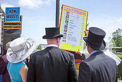 © Licensed to London News Pictures. 17/06/2014. Ascot, UK. People place bets on the colour of the Queen's hat. Day one at Royal Ascot 17th June 2014. Royal Ascot has established itself as a national institution and the centrepiece of the British social calendar as well as being a stage for the best racehorses in the world. Photo credit : Stephen Simpson/LNP